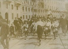 """Children marching in street during an event.  """"Italian young __ association __ wars  Churchill the great war""""  1935"""