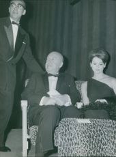 """Otto Ludwig Preminger presented in Paris the premiere of his new films  """"Tempete a Washington"""" together with an actress, Gene Tierney."""