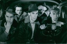 """Hans Erik William Sundberg, Lennart Lundh, Sven-Eric Gamble, Ake Hylén, Hans Dahlberg, and Arne Ragneborn inside a car in one of the scenes from the 1950 film, """"While the City Sleeps""""."""