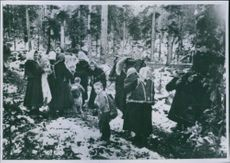 The wives and children of the partisans pull themselves away in the woods while the shrines are in progress. 1943