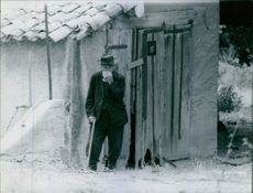 Gaston Dominici standing outside the hut. 1960