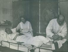 A doctor and a nurse looking after the patient in Netherlands during World War II, 1914.