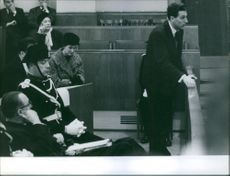 Men in the courtroom in during the Jaccoud Case.