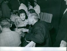 Silvana Pampanini feeding some grapes to a man at the Italian film week in Moscow, Russia.