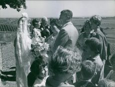 Liselotte Pulver with family and friends on her wedding day.