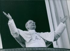 Pope Pius XII giving a speech at the terrace during a gathering.