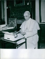 Pope Pius XII pictured typing.