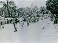 Soldiers marching on the road in Congo, 1964.