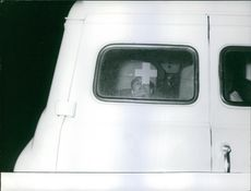 A photo of a man lying in an ambulance looking outside.  Jaccoud process