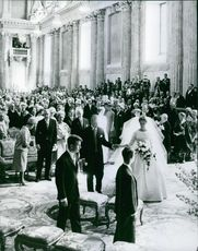Marriage ceremony of Princess Birgitta of Sweden and Prince Johann Georg of Hohenzollern.
