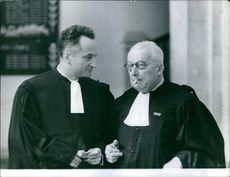 """Two lawyers talking to each other during the case proceedings of Marie Besnard.  """"Marie Besnard""""  1961"""