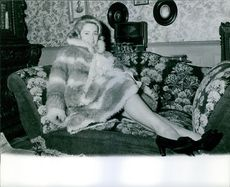 Ulla Jacobsson sitting on the couch.
