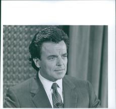 Ray Wise sitting alone and looking at something during a scene in film Red Sun.