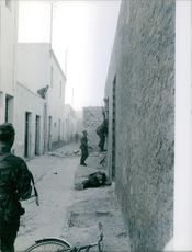 Soldiers in street during war. 1961