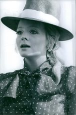 Geneviève Waïte wearing a hat and polka dots blouse. 1968.