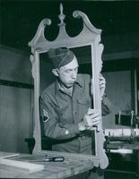 A soldier making a wooden frame during U.S.A war II, 1946.