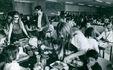 People dining in a restaurant, 1970.