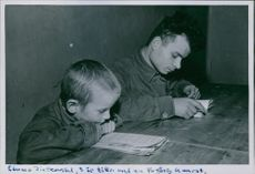 Children siting and reading book in Poland, 1946.