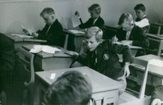 Carl XVI Gustaf as a kid, in a classroom.