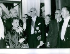 A photo of Urho Kekkonen a Finnish politician who served as Prime Minister of Finland (1950–1953, 1954–1956) and later as the eighth and longest-serving President of Finland (1956–1982), standing in the middle.
