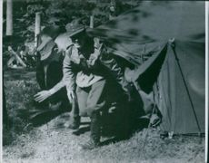 A photo of soldiers came out from their tent laughing during the World war II 1941 in Finland.
