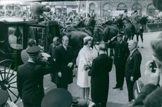 A man greets Princess Benedikte of Denmark and Richard, 6th Prince of Sayn-Wittgenstein-Berleburg, upon their arrival.