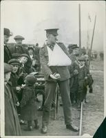 """The wounded corporal could not resist the invitation to have a shot at """"Kaiser Bill"""".1915"""