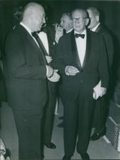 Otto Ludwig Preminger talking to a man, 1962.