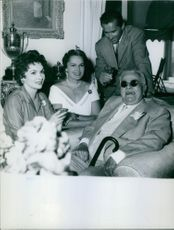 Aga Khan III and wife Begum Aga Khan with unknown man and woman. 1960.