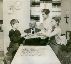Carl Jularbo having a meal with his family. His wife, Mrs. Sally and children Carl Gustaf and Elvy. 1958.