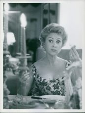 Martine Carol looking in the mirror, 1956.