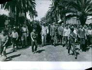 People protesting in street.