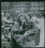 A man and woman siting while they looking each other during Holland War, 1945.