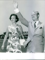 Richard, 6th Prince of Sayn-Wittgenstein-Berleburg, waves his hand with Princess Benedikte by his side.