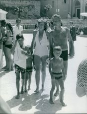 Eunice Shriver-Kennedy with her husband and their children at the Montecarlo beach. 1969.