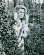 Ulla Jacobsson standing and posing with a furry dress, 1967.