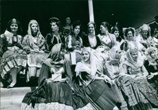 Women gathered in traditional clothing.