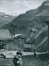 View of man travelling in trolleybus and mountain.