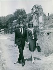 Xavier, Duke of Parma and Piacenza walking with woman. 1964