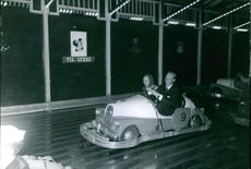Richard, 6th Prince of Sayn-Wittgenstein-Berleburg and Princess Benedikte of Denmark riding the bumper car. 1967.
