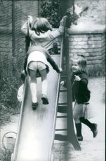 Princess Alexia playing with other children on a slide.