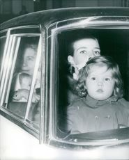 Two women with their children in a vehicle, 1968.