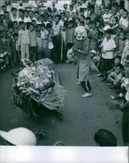 People gathered on the road to see the drama performed by the performers.