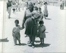 A pregnant woman walking with her children in Egypt. Photo taken on July 17, 1967.