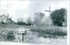 Tomb and a sign board in village of victims of war crimes.  1971
