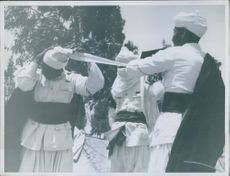 The binding of turbans is not as simple and as our picture shows, teamwork.