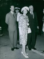 Elizabeth II, Philip and a few other people traveling together, 1963.