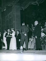 Elizabeth II and Prince Philip in a ceremony during one of their travels, 1963.