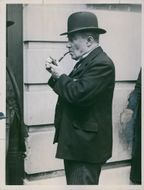 A study of Mr. Stanley Baldwin leader of the National Conservative party, smoking with a pipe.