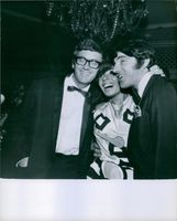 Leslie Bricusse, Shirley Bassey and Anthony Newley photographed smiling together.